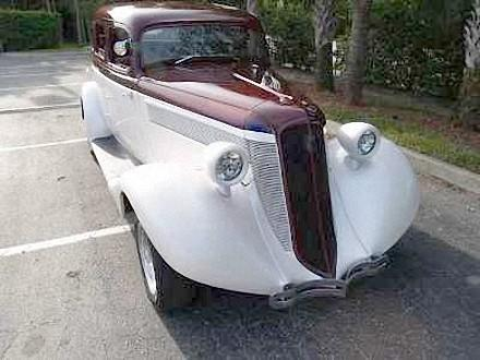 Front Right Maroon and White 1935 Studebaker Dictator Car Picture