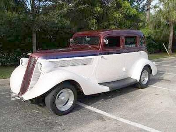 Front Left Maroon and White 1935 Studebaker Dictator Car Picture